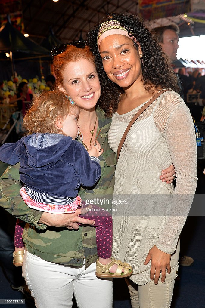 Actress <a gi-track='captionPersonalityLinkClicked' href=/galleries/search?phrase=Sarah+Rafferty&family=editorial&specificpeople=668359 ng-click='$event.stopPropagation()'>Sarah Rafferty</a> (L) and actress <a gi-track='captionPersonalityLinkClicked' href=/galleries/search?phrase=Gina+Torres&family=editorial&specificpeople=581171 ng-click='$event.stopPropagation()'>Gina Torres</a> attend the P.S. Arts Express Yourself 2013 event held at Barker Hangar on November 17, 2013 in Santa Monica, California.