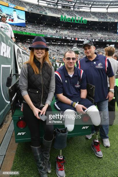 Actress Sarah Rafferty meets with Wounded Warriors when she attends the Cleveland Browns vs New York Jets game at MetLife Stadium on December 22 2013...