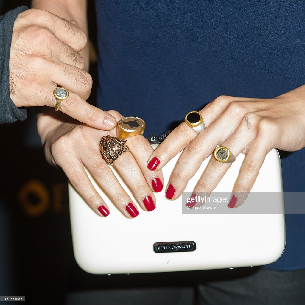 Actress Sarah Shahi (jewelry and handbag detail) attends the Eli Halili Soho Boutique Grand Opening with Vogue Gioiello on October 15, 2013 in New York City.