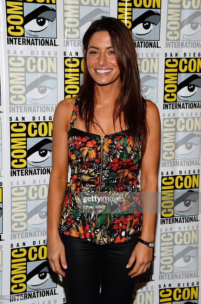 Actress <a gi-track='captionPersonalityLinkClicked' href=/galleries/search?phrase=Sarah+Shahi&family=editorial&specificpeople=538555 ng-click='$event.stopPropagation()'>Sarah Shahi</a> attends the 'Person of Interest' press line during Comic-Con International 2013 at the Hilton San Diego Bayfront Hotel on July 20, 2013 in San Diego, California.