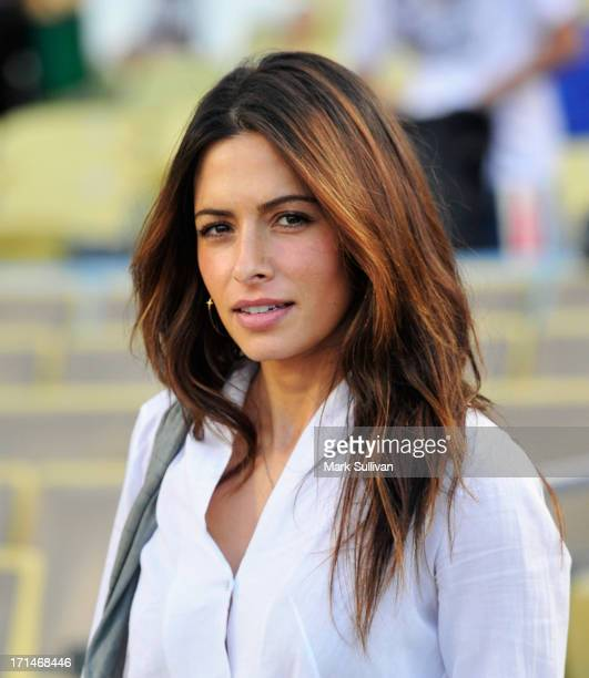 Actress Sarah Shahi on the field prior to throwing out the ceremonial first pitch before the game between the Los Angeles Dodgers and the San...