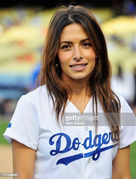 Actress Sarah Shahi warms up prior to throwing out the ceremonial first pitch before the game between the Los Angeles Dodgers and the San Francisco...