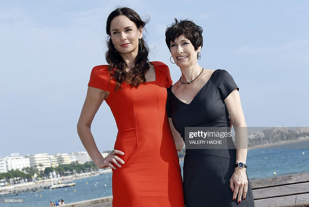US actress Sarah Wayne Callies (L) and US executive producer Gale Anne Hurd (R) pose during a photocall for the TV show 'The Walking Dead' as part of the Mipcom international audiovisual trade show at the Palais des Festivals, in Cannes, southeastern France, on October 9, 2012.