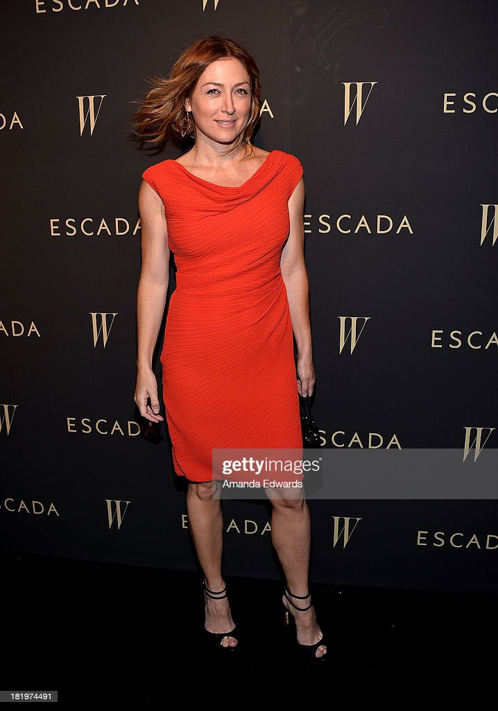 Actress <a gi-track='captionPersonalityLinkClicked' href=/galleries/search?phrase=Sasha+Alexander&family=editorial&specificpeople=215373 ng-click='$event.stopPropagation()'>Sasha Alexander</a> arrives at the Escada and W Magazine shopping event benefiting the Cool Earth Organization at Escada Boutique on September 26, 2013 in Beverly Hills, California.
