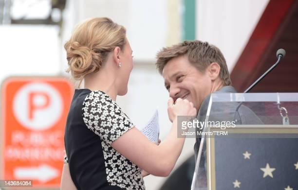 Actress Scarlett Johansson and actor Jeremy Renner pose as Scarlett Johansson is honored with a star on The Hollywood Walk Of Fame on May 2 2012 in...