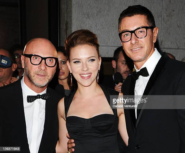 Actress Scarlett Johansson and designers Domenico Dolce and Stefano Gabbana attend a dinner at the Dolce Gabbana Gold Restaurant as part Milan...