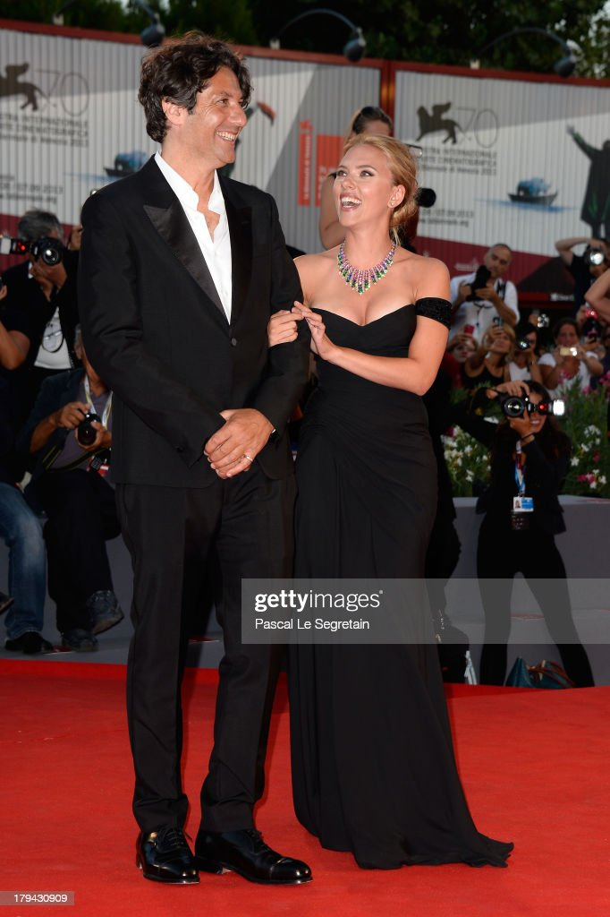 Actress Scarlett Johansson (R) and director Jonathan Glazer attend 'Under The Skin' Premiere during the 70th Venice International Film Festival at Palazzo del Cinema on September 3, 2013 in Venice, Italy.
