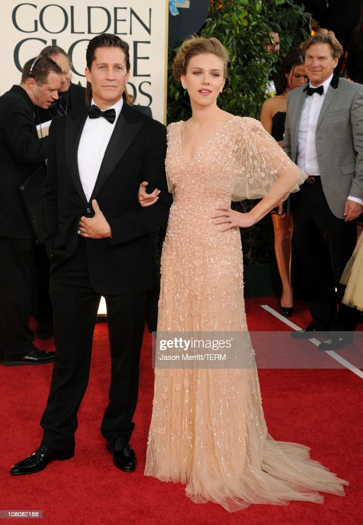 Actress Scarlett Johansson (R) and guest arrive at the 68th Annual Golden Globe Awards held at The Beverly Hilton hotel on January 16, 2011 in Beverly Hills, California.