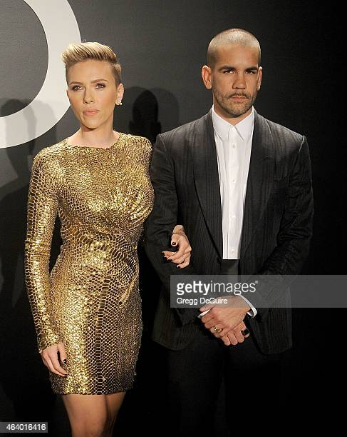 Actress Scarlett Johansson and husband Romain Dauriac arrive at the Tom Ford Autumn/Winter 2015 Womenswear Collection Presentation at Milk Studios on...