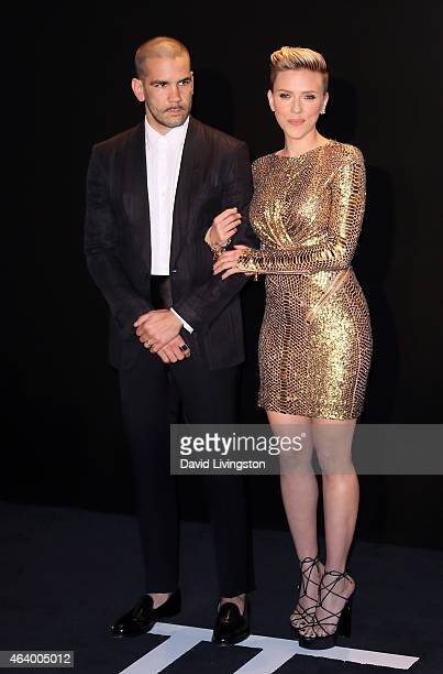 Actress Scarlett Johansson and husband Romain Dauriac attend the Tom Ford Autumn/Winter 2015 Womenswear Collection presentation at Milk Studios on...