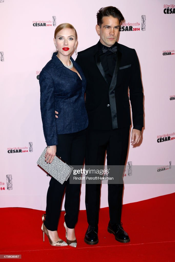 Actress Scarlett Johansson and Romain Dauriac arrive for the 39th Cesar Film Awards 2014 at Theatre du Chatelet on February 28, 2014 in Paris, France.