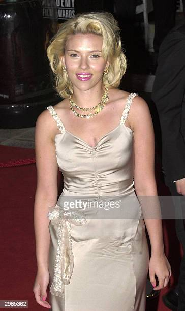 Actress Scarlett Johansson arrives for the BAFTA British Academy Film Awards Leicester Square London 15 February 2004 AFP PHOTO/MARTYN HAYHOW
