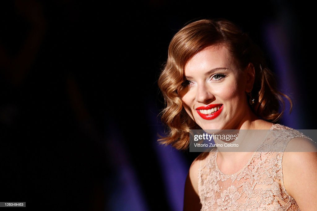 Actress <a gi-track='captionPersonalityLinkClicked' href=/galleries/search?phrase=Scarlett+Johansson&family=editorial&specificpeople=171858 ng-click='$event.stopPropagation()'>Scarlett Johansson</a> attends the Dolce & Gabbana Spring/Summer 2012 fashion show as part Milan Womenswear Fashion Week on September 25, 2011 in Milan, Italy.