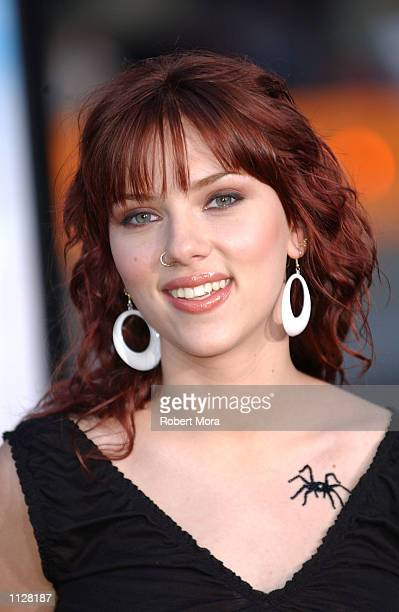 Actress Scarlett Johansson attends the world premiere of 'Eight Legged Freaks' at Grauman's Chinese Theater on July 16 2002 in Hollywood California...