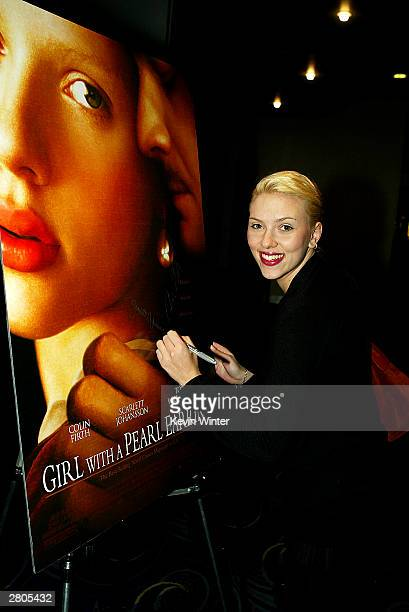Actress Scarlett Johansson autographs a poster at Variety's Screening Series 'Girl With A Pearl Earring' at the Pacific Galleria Theater on December...