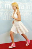 Actress Scarlett Johansson dashes past during a photo call at the 60th Venice Film Festival August 29 2003 in Venice Italy Sofia Coppola is in Venice...
