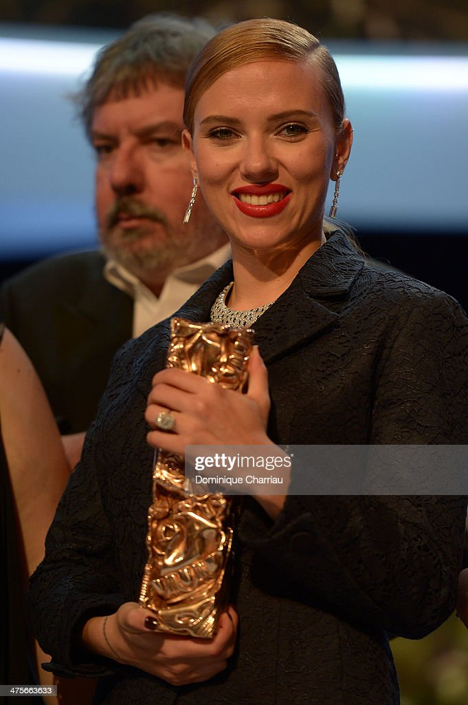 Actress <a gi-track='captionPersonalityLinkClicked' href=/galleries/search?phrase=Scarlett+Johansson&family=editorial&specificpeople=171858 ng-click='$event.stopPropagation()'>Scarlett Johansson</a> holds the Honorary Cesar on stage during the 39th Cesar Film Awards 2014 at Theatre du Chatelet on February 28, 2014 in Paris, France.