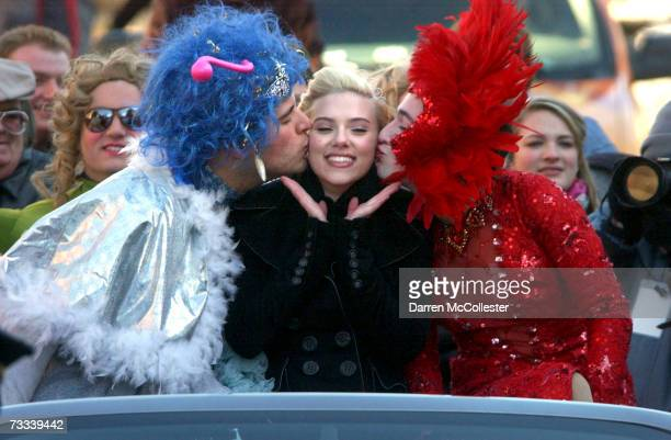Actress Scarlett Johansson is paraded through Harvard Square alongside Justin Rodriguez and Josh Brenner of Harvard University's Hasty Pudding...
