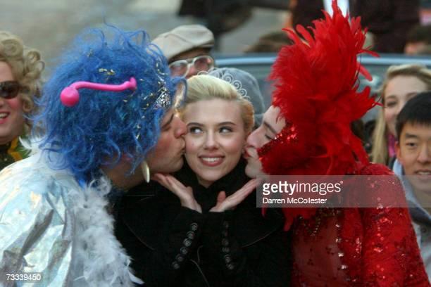 Actress Scarlett Johansson is paraded through Harvard Square alongside Justin Rodriguez and Josh Brenner of Harvard University's Hasty Pudding...
