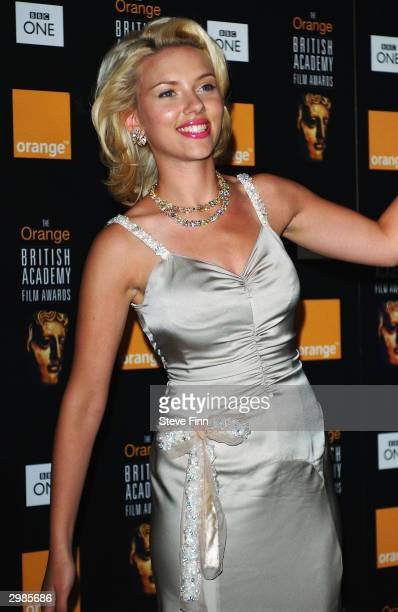Actress Scarlett Johansson poses in the pressroom at 'The Orange British Academy Film Awards' at The Odeon Leicester Square on February 15 2004 in...