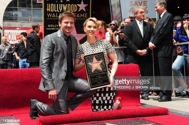 Actress Scarlett Johansson poses with actor Jeremy Renner at a ceremony for the unveiling of Johansson's Star on the Hollywood Walk of Fame on May 2...
