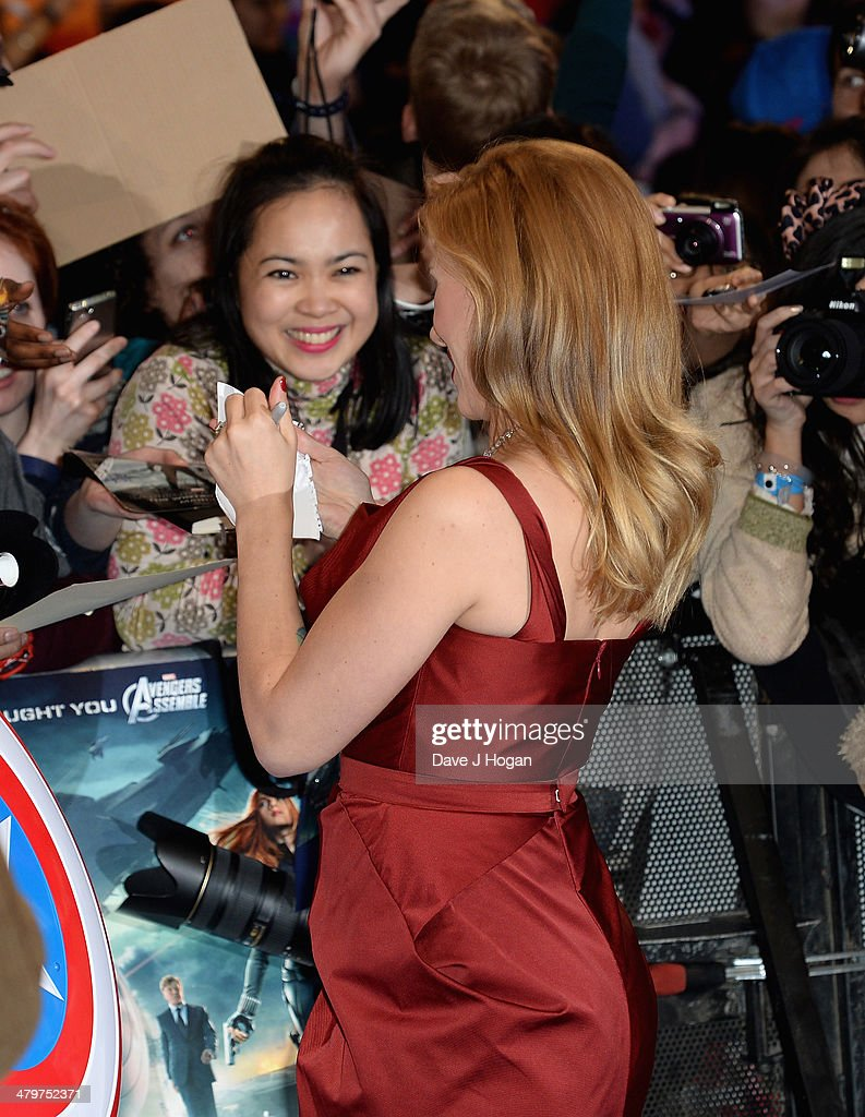 Actress Scarlett Johansson signs autographs for fans as she attends the 'Captain America: The Winter Soldier' UK film premiere at Westfield on March 20, 2014 in London, England.