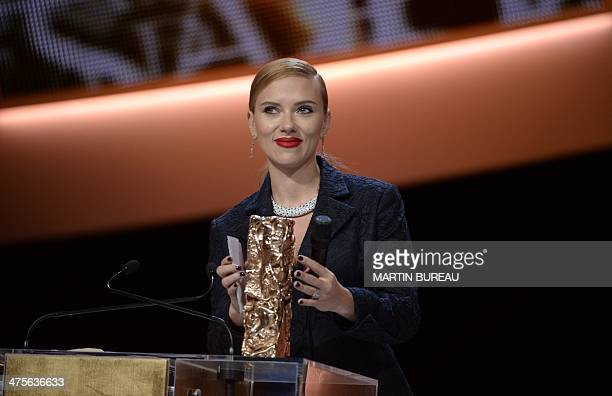US actress Scarlett Johansson smiles on stage after being awarded with an Honorary award during the 39th edition of the Cesar awards ceremony in...
