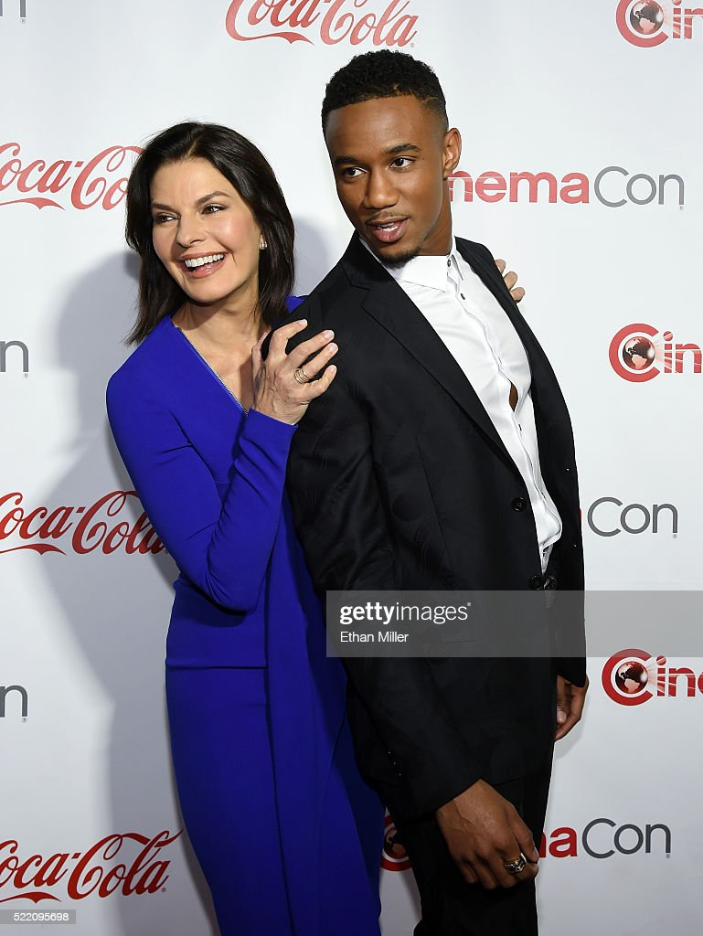 Actress Sela Ward (L) and actor Jessie Usher, two of the recipients of the Ensemble of the Universe Award for 'Independence Day: Resurgence,' attend the CinemaCon Big Screen Achievement Awards brought to you by the Coca-Cola Company at Omnia Nightclub at Caesars Palace during CinemaCon, the official convention of the National Association of Theatre Owners, on April 14, 2016 in Las Vegas, Nevada.