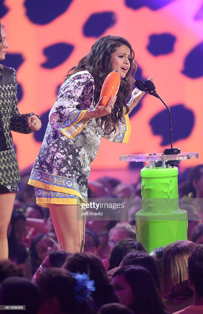 Actress Selena Gomez accepts the award for Favorite Female Singer onstage at Nickelodeon's 27th Annual Kids' Choice Awards at USC Galen Center on March 29, 2014 in Los Angeles, California.