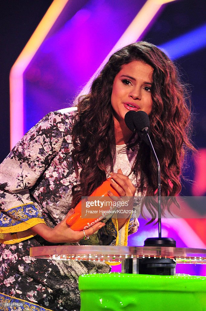 Actress Selena Gomez accepts the award for Favorite Female Singer onstage during Nickelodeon's 27th Annual Kids' Choice Awards held at USC Galen Center on March 29, 2014 in Los Angeles, California.