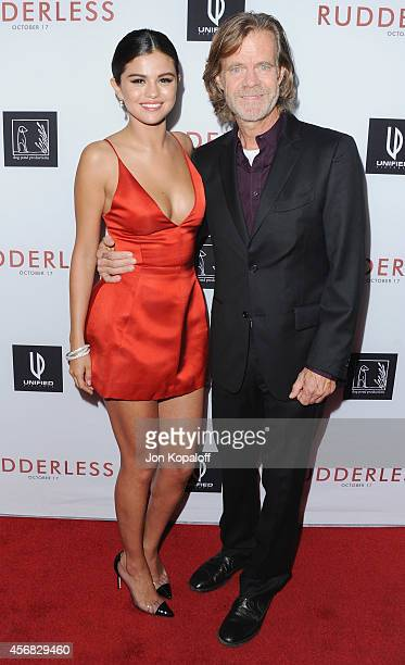 Actress Selena Gomez and actor William H Macy arrive at the Los Angeles VIP Screening 'Rudderless' at the Vista Theatre on October 7 2014 in Los...