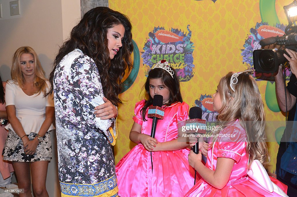 Actress Selena Gomez and TV personalities Sophia Grace Brownlee and Rosie Grace McClelland attend Nickelodeon's 27th Annual Kids' Choice Awards held at USC Galen Center on March 29, 2014 in Los Angeles, California.