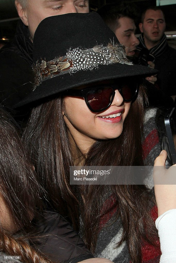 Actress <a gi-track='captionPersonalityLinkClicked' href=/galleries/search?phrase=Selena+Gomez&family=editorial&specificpeople=4295969 ng-click='$event.stopPropagation()'>Selena Gomez</a> arrives at Roissy airport on February 16, 2013 in Paris, France.
