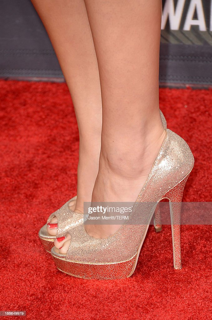 Actress Selena Gomez (shoe detail) arrives at the 2013 MTV Movie Awards at Sony Pictures Studios on April 14, 2013 in Culver City, California.