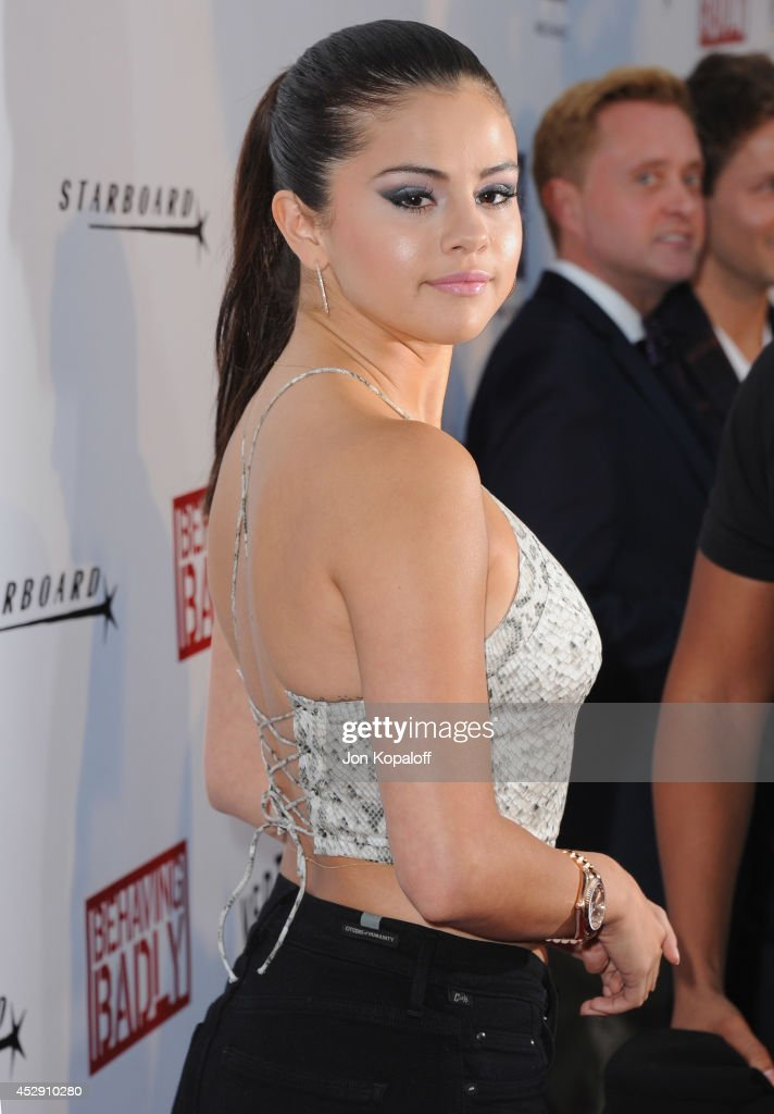 Actress <a gi-track='captionPersonalityLinkClicked' href=/galleries/search?phrase=Selena+Gomez&family=editorial&specificpeople=4295969 ng-click='$event.stopPropagation()'>Selena Gomez</a> arrives at the Los Angeles Premiere 'Behaving Badly' at ArcLight Hollywood on July 29, 2014 in Hollywood, California.