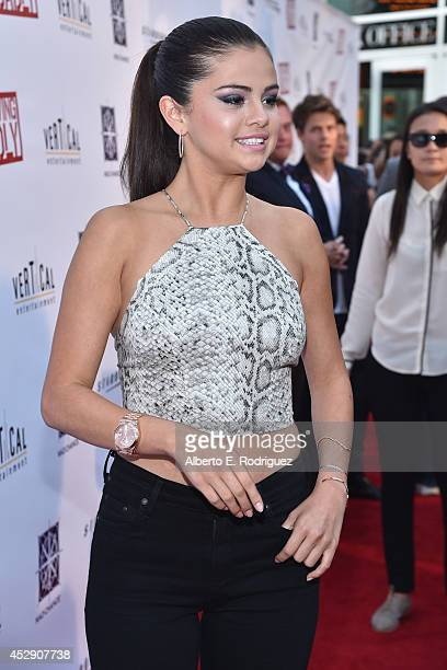Actress Selena Gomez arrives to the premiere of Mad Chance's 'Behaving Badly' at the ArcLight Hollywood on July 29 2014 in Hollywood California