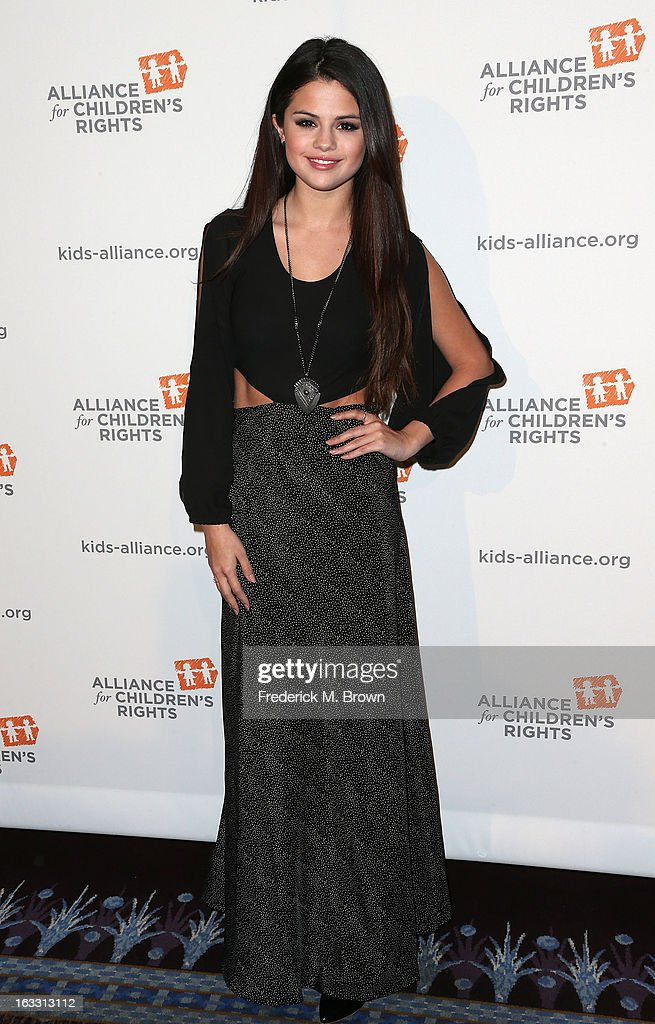 Actress <a gi-track='captionPersonalityLinkClicked' href=/galleries/search?phrase=Selena+Gomez&family=editorial&specificpeople=4295969 ng-click='$event.stopPropagation()'>Selena Gomez</a> attends The Alliance For Children's Rights' 21st Annual Dinner at The Beverly Hilton Hotel on March 7, 2013 in Beverly Hills, California.