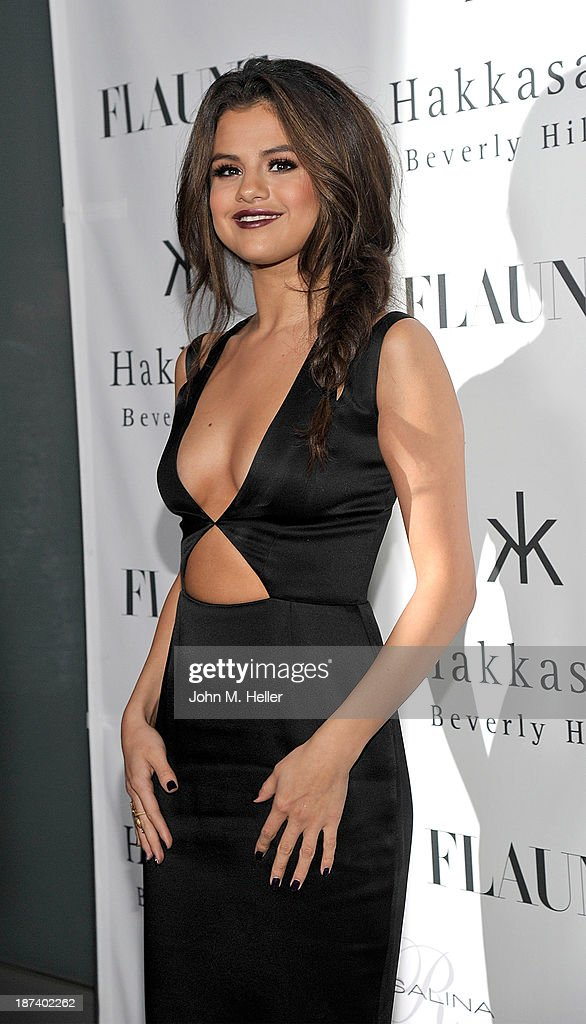 Actress <a gi-track='captionPersonalityLinkClicked' href=/galleries/search?phrase=Selena+Gomez&family=editorial&specificpeople=4295969 ng-click='$event.stopPropagation()'>Selena Gomez</a> attends the Flaunt Magazine En Garde! Issue launch party with <a gi-track='captionPersonalityLinkClicked' href=/galleries/search?phrase=Selena+Gomez&family=editorial&specificpeople=4295969 ng-click='$event.stopPropagation()'>Selena Gomez</a> and Amanda De Cadenet at Hakkasan Restaurant Beverly Hills on November 7, 2013 in Beverly Hills, California.