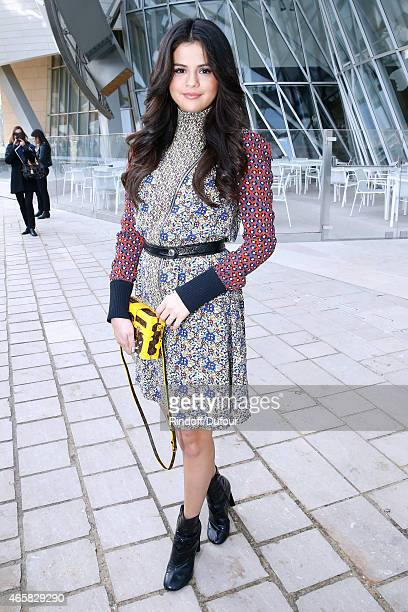 Actress Selena Gomez attends the Louis Vuitton show as part of the Paris Fashion Week Womenswear Fall/Winter 2015/2016 on March 11 2015 in Paris...