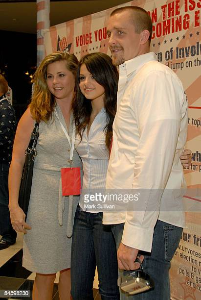 Actress Selena Gomez center with her mother Mandy Cornett and step father Brian Teefey attend UR Votes Count hosted by Selena Gomez on August 16 2008...