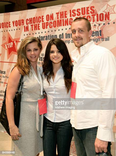 Actress Selena Gomez posing with her mother Mandy Teefy and step father Brian Teefey at the UR Votes Count hosted by Selena Gomez on August 16 2008...