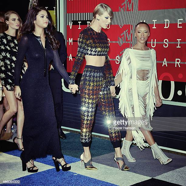 Actress Selena Gomez singer Taylor Swift and actress Serayah arrive at the 2015 MTV Video Music Awards at Microsoft Theater on August 30 2015 in Los...
