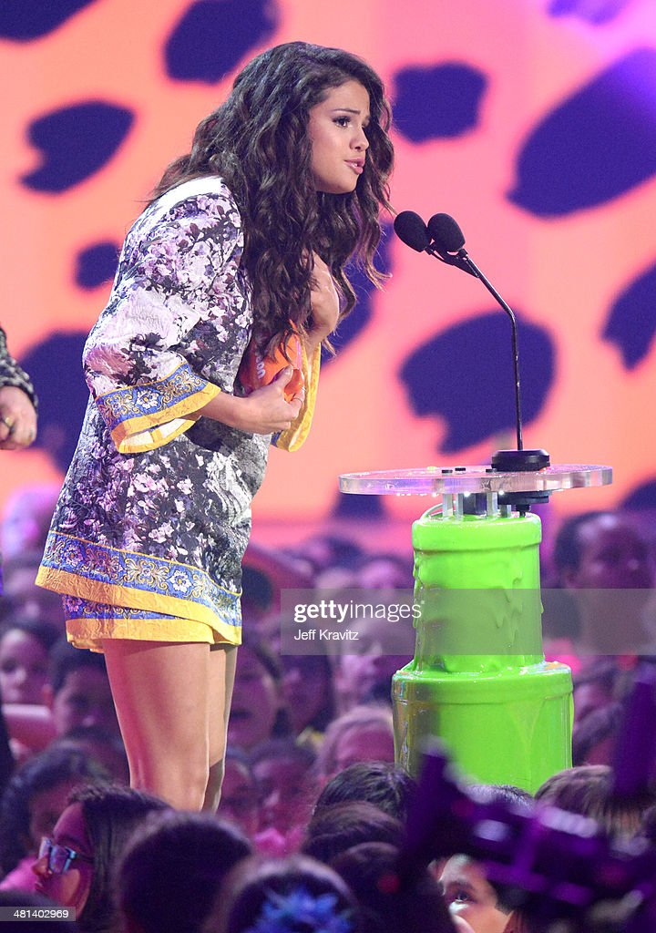 Actress Selena Gomez speaks onstage at Nickelodeon's 27th Annual Kids' Choice Awards at USC Galen Center on March 29, 2014 in Los Angeles, California.