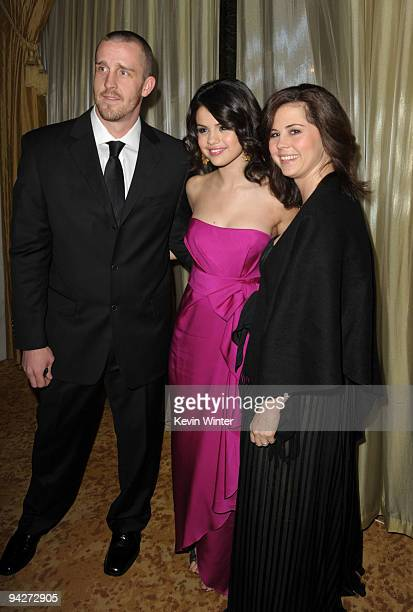 Actress Selena Gomez with her mother Mandy Cornett and step father Brian Teefey attend the UNICEF Ball honoring Jerry Weintraub held at the Beverly...
