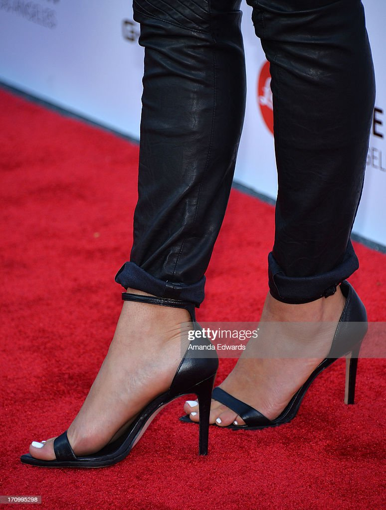 Actress Serinda Swan (shoe detail) arrives at the Leica Store Los Angeles Grand Opening at Leica on June 20, 2013 in Los Angeles, California.