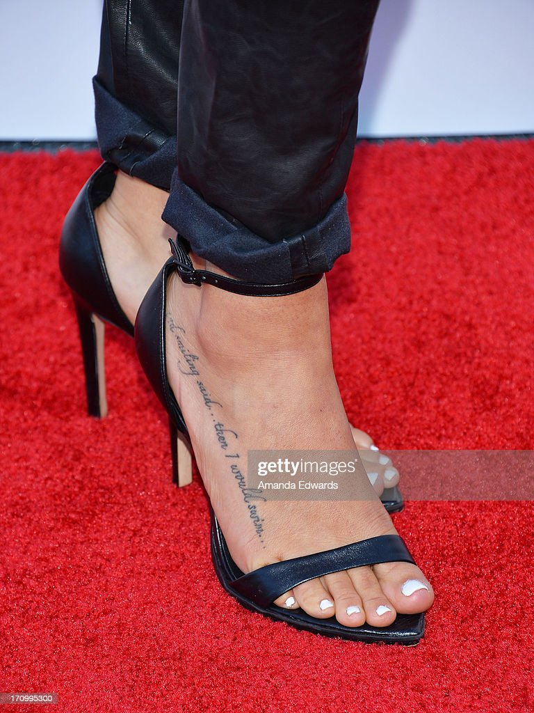 Actress Serinda Swan (shoe and tattoo detail) arrives at the Leica Store Los Angeles Grand Opening at Leica on June 20, 2013 in Los Angeles, California.
