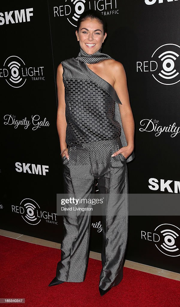 Actress <a gi-track='captionPersonalityLinkClicked' href=/galleries/search?phrase=Serinda+Swan&family=editorial&specificpeople=4388541 ng-click='$event.stopPropagation()'>Serinda Swan</a> attends the launch of the Redlight Traffic app at the Dignity Gala at The Beverly Hilton Hotel on October 18, 2013 in Beverly Hills, California.