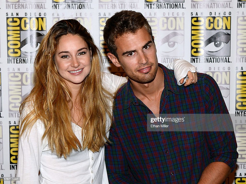 Actress <a gi-track='captionPersonalityLinkClicked' href=/galleries/search?phrase=Shailene+Woodley&family=editorial&specificpeople=676833 ng-click='$event.stopPropagation()'>Shailene Woodley</a> (L) and actor <a gi-track='captionPersonalityLinkClicked' href=/galleries/search?phrase=Theo+James&family=editorial&specificpeople=7989783 ng-click='$event.stopPropagation()'>Theo James</a> attend the 'Ender's Game' and 'Divergent' press line during Comic-Con International 2013 at the Hilton San Diego Bayfront Hotel on July 18, 2013 in San Diego, California.