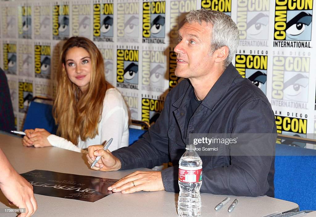 Actress Shailene Woodley (L) and director Neil Burger attend the 'Ender's Game' and 'Divergent' cast autograph signing during Comic-Con International 2013 at San Diego Convention Center on July 18, 2013 in San Diego, California.