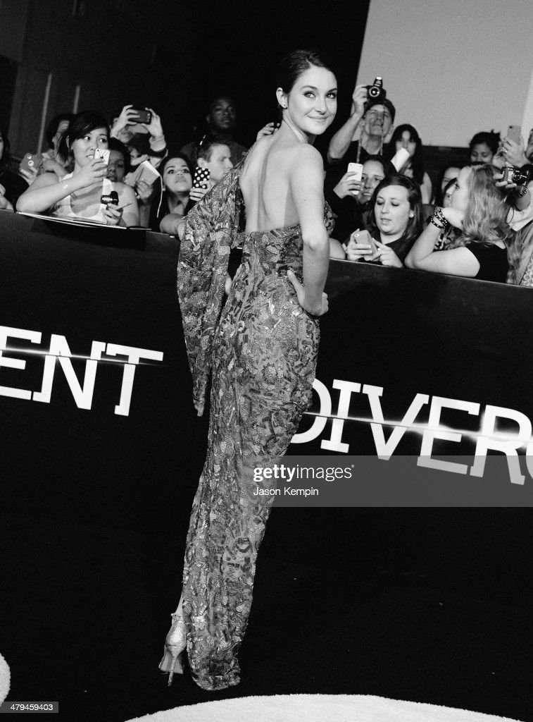 Actress <a gi-track='captionPersonalityLinkClicked' href=/galleries/search?phrase=Shailene+Woodley&family=editorial&specificpeople=676833 ng-click='$event.stopPropagation()'>Shailene Woodley</a> attends Summit Entertainment's 'Divergent' Premiere at Regency Bruin Theatre on March 18, 2014 in Los Angeles, California.